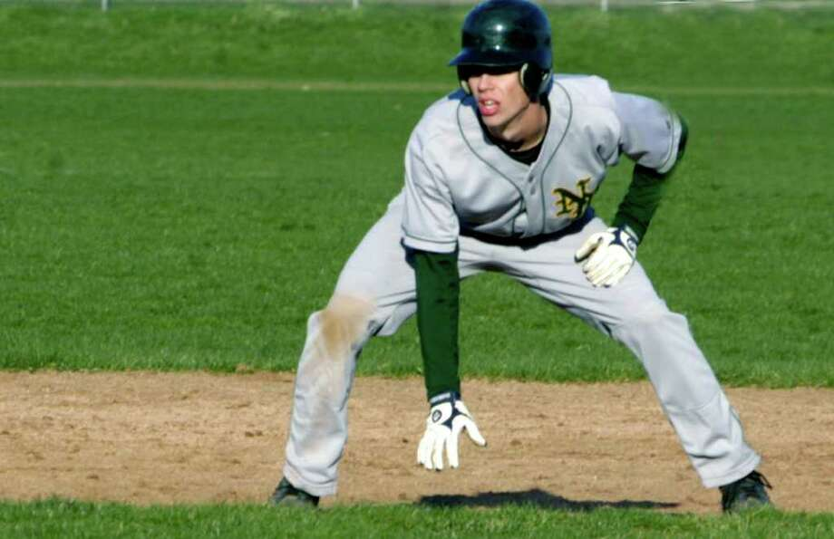 SPECTRUM/Greg Ostner of New Milford High School baseball takes a strong lead off second base April 21 during the Green Wave's 8-7 victory over visiting Bethel. Photo: Norm Cummings / The News-Times