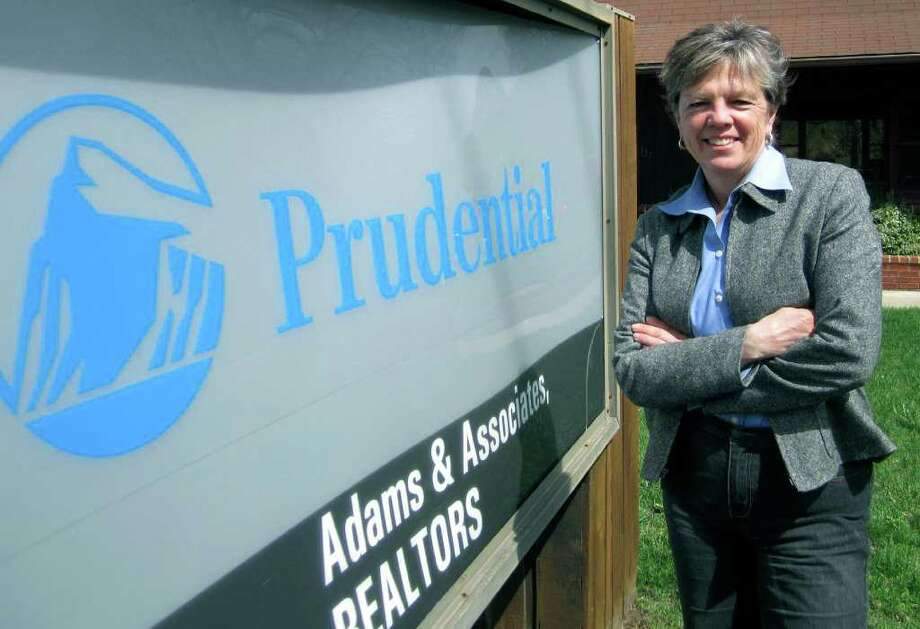 SPECTRUM/Liddy Adams has many years' experience working with patrons of Prudential Adams & Associates along Route 7 South in New Milford. April 2011 Photo: Norm Cummings / The News-Times
