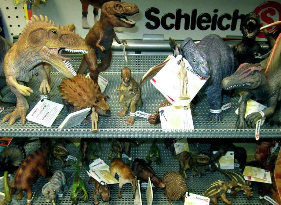 SPECDTRUM/They may be extinct elsewhere but plenty of dinosaurs roam the well-stocked shelves at Nordica Toys in New Milford. May 2, 2011 Photo: Norm Cummings / The News-Times