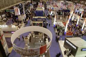 Visitors to the annual Offshore Technology Conference in Houston walk through the exhibits Wednesday, May 4, 2011. More than 65,000 people and 2,000 exhibitors representing more than 110 countries attend the four-day conference.