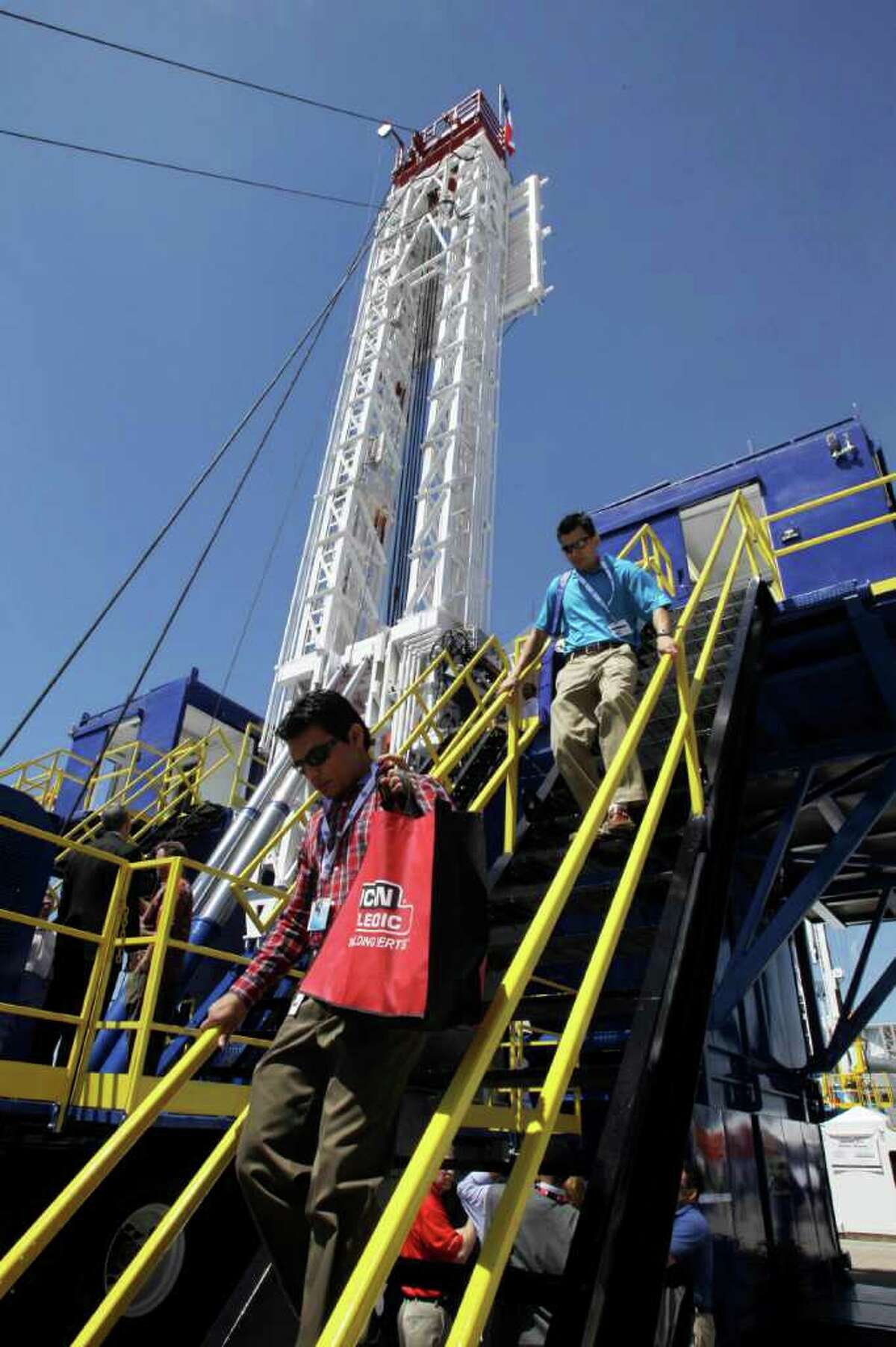 Visitors leave a drilling platform displayed at the annual Offshore Technology Conference Wednesday, May 4, 2011, in Houston. More than 65,000 people and 2,000 exhibitors representing more than 110 countries attend the four day conference.