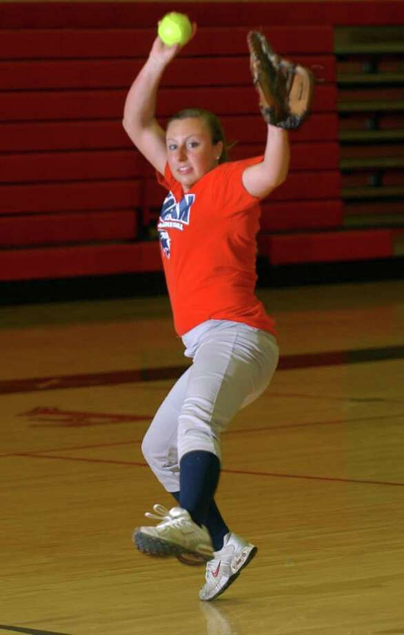 Pitcher Taylor Harkness during softball practice at Foran High in Milford, Conn. on Wednesday May 4, 2011. Photo: Christian Abraham / Connecticut Post