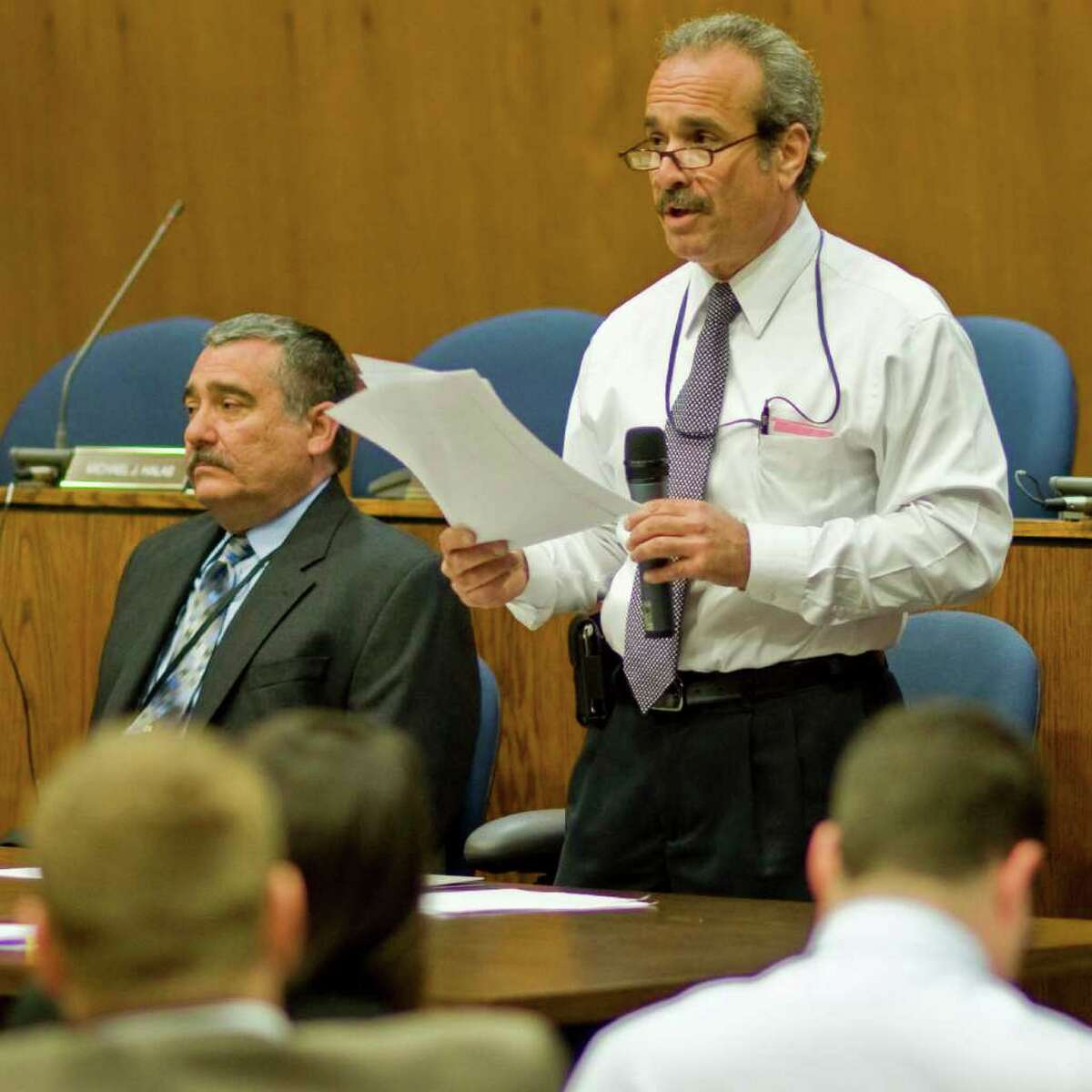 Danbury Postmaster Philip Gioia, left, and Manager for Postal Operations, Guy Polacco address the community meeting at City Hall regarding the potential closure of the Main Street Post Office. Wednesday, May 4, 2011