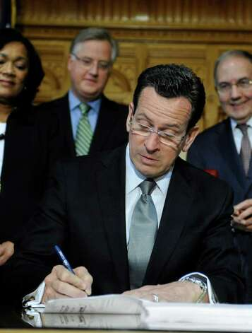 Connecticut Gov. Dannel P. Malloy signs a two-year $40.1 billion budget bill into law at the Capitol in Hartford, Conn., Wednesday, May 4, 2011.  (AP Photo/Jessica Hill) Photo: Jessica Hill, AP / AP2011