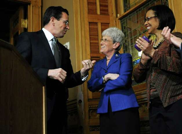 Connecticut Gov. Dannel P. Malloy, left,  acknowledges Lt. Gov. Nancy Wyman, center, after signing a two-year $40.1 billion budget bill into law as State Rep. Toni Walker, D-New Haven, right, looks on, at the Capitol in Hartford, Conn., Wednesday, May 4, 2011.  (AP Photo/Jessica Hill) Photo: Jessica Hill, AP / AP2011