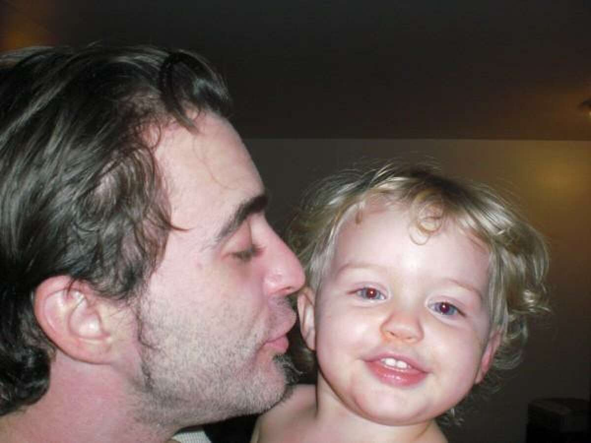 Chris Allgood kisses his daughter Anika in a photo that appeared on his Myspace page.