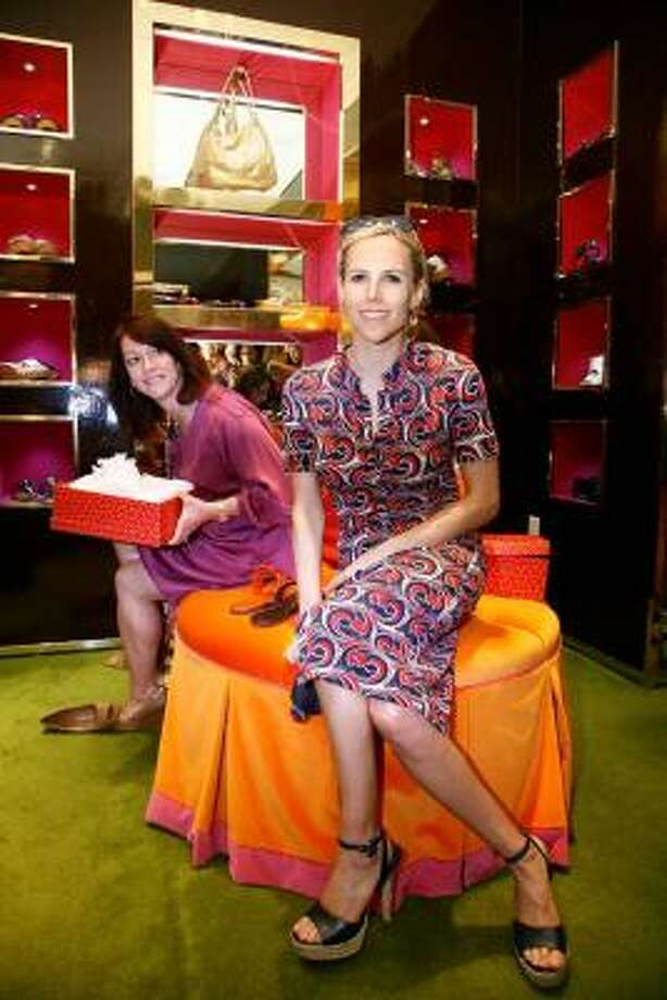Fashion designer Tory Burch held at a reception in her store in the Galleria.  At left, Kelley Sobiesk does some shoe shopping. Photo: JOHNEVERETT