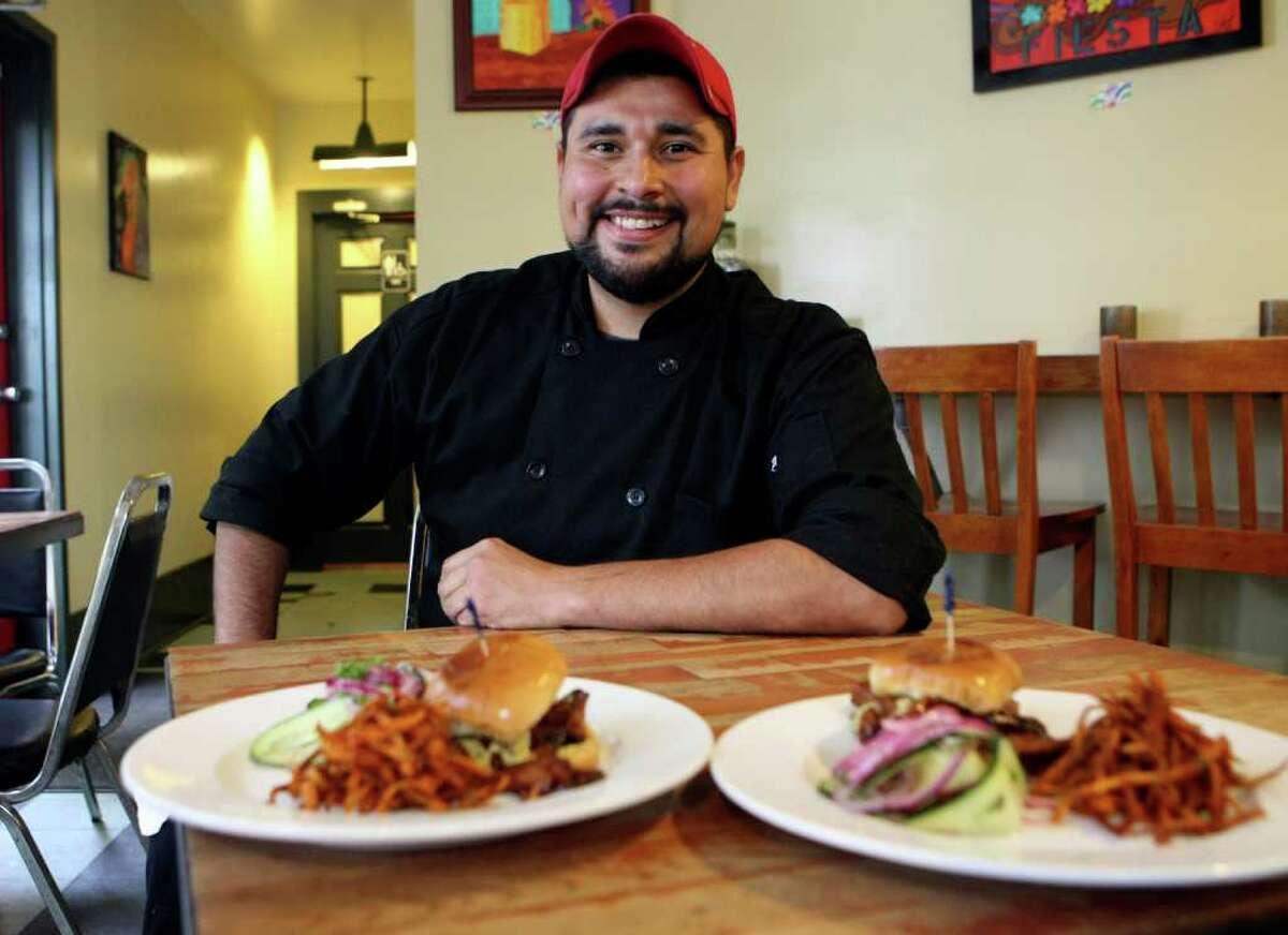 CONEXION: Jose Alfredo Cruz, who works at La Tuna Grill during the day, runs a vegetarian catering business. HELEN L. MONTOYA/hmontoya@conexionsa.com