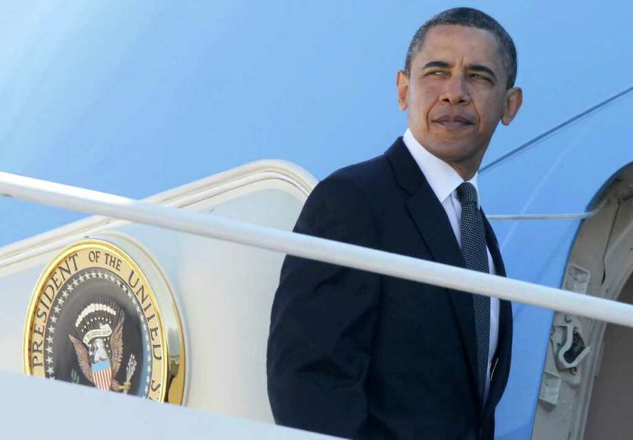 President Barack Obama boards Air Force One at Andrews Air Force Base, Md., Thursday, May 5, 2011, as he travels to New York City where he will visit Ground Zero and meet with first responders and family members of victims of the Sept. 11, 2001 attacks after he announced Sunday that Osama bin Laden had been killed by U.S. forces. (AP Photo/Charles Dharapak) Photo: Charles Dharapak, AP / AP2011