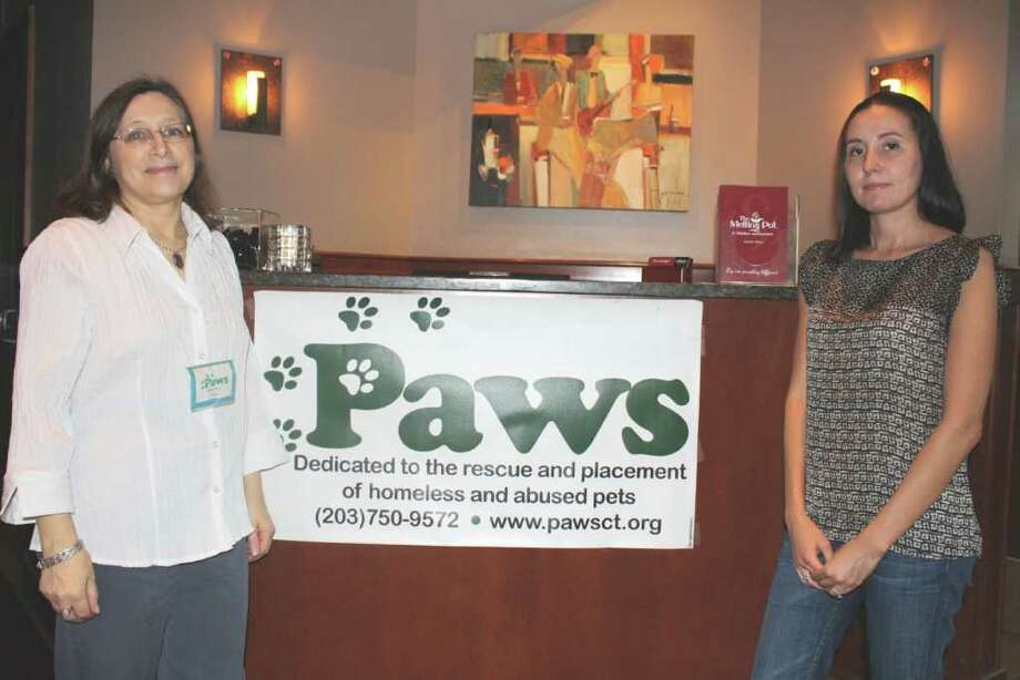 Cissy Tiernan  and Roxy Waters prepared the Melting Pot for a FONDUE-Raiser to help raise money for the shelter. Photo: Contributed Photo / Darien News