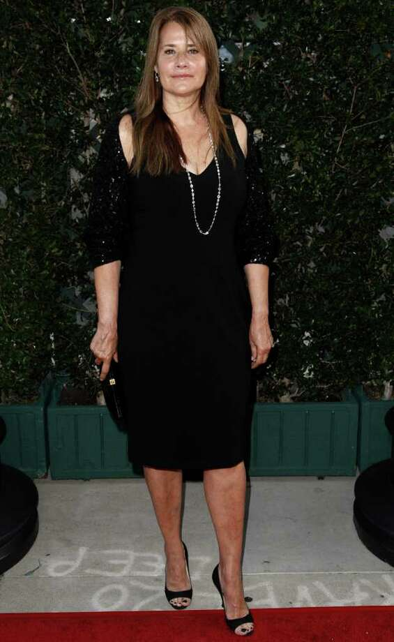 Actress Lorraine Bracco arrives at The Academy of Motion Picture Arts and Sciences Tribute honoring Sophia Loren in Beverly Hills, Calif., Wednesday, May 4, 2011.  Loren's life and career will be celebrated by friends and colleagues Wednesday. Photo: AP