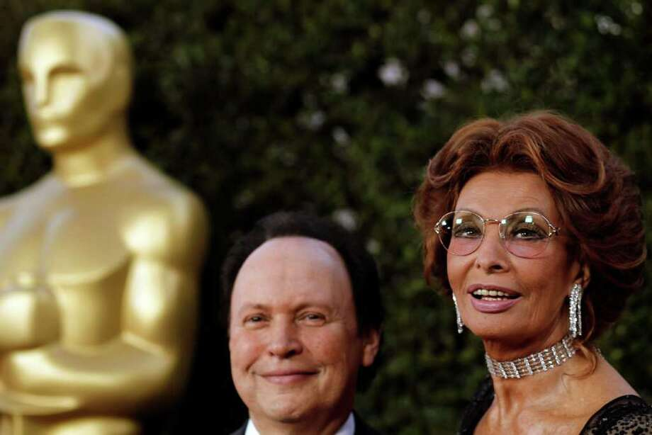 Actress Sophia Loren, right, and Billy Crystal arrive at The Academy of Motion Picture Arts and Sciences Tribute honoring her in Beverly Hills, Calif., Wednesday, May 4, 2011.  Loren's life and career will be celebrated by friends and colleagues Wednesday. Photo: AP