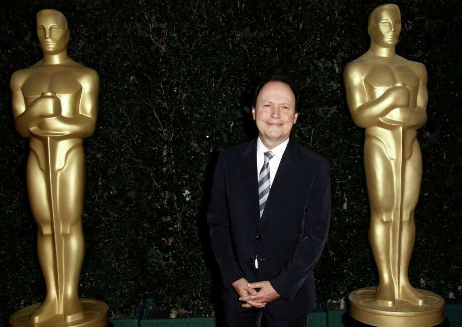 Actor Billy Crystal arrives at The Academy of Motion Picture Arts and Sciences Tribute honoring Sophia Loren in Beverly Hills, Calif., Wednesday, May 4, 2011.  Loren's life and career will be celebrated by friends and colleagues Wednesday. Photo: AP