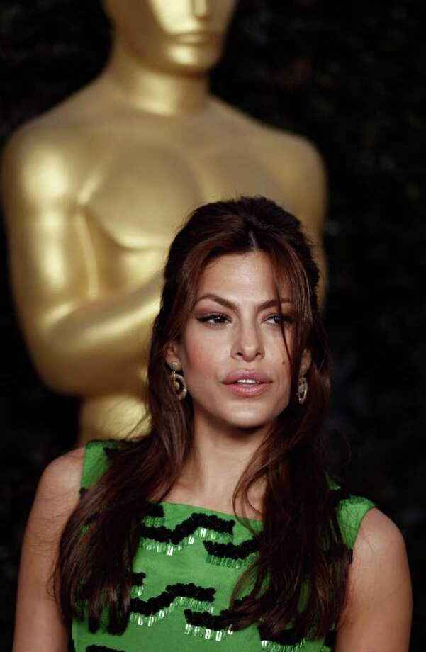 Actress Eva Mendes arrives at The Academy of Motion Picture Arts and Sciences Tribute honoring Sophia Loren in Beverly Hills, Calif., Wednesday, May 4, 2011.  Loren's life and career will be celebrated by friends and colleagues Wednesday. Photo: AP