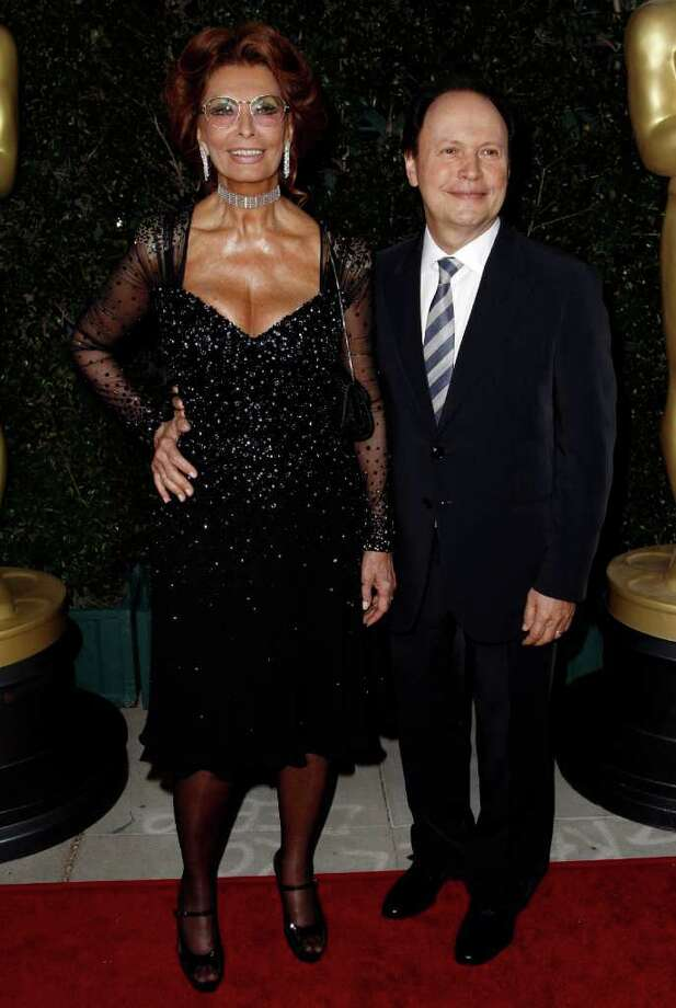 Actress Sophia Loren, left, and Billy Crystal arrive at The Academy of Motion Picture Arts and Sciences Tribute honoring her in Beverly Hills, Calif., Wednesday, May 4, 2011.  Loren's life and career will be celebrated by friends and colleagues Wednesday. Photo: AP