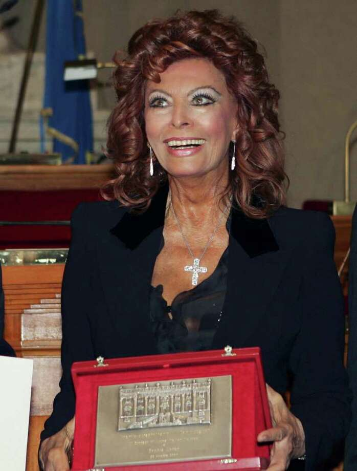Italian movie legend Sophia Loren holds the Campidoglio award she received by the city of Rome in a collateral event of the Rome Film Festival, at Rome's town hall, Saturday, Oct. 20, 2007. Photo: RICCARDO DE LUCA, AP / AP