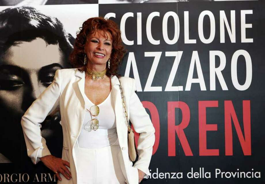 "Rome, ITALY: Italian movie star Sophia Loren poses during the presentation of the exhibit ""Scicolone, Lazzaro, Loren"" at the Complesso del Vittoriano, in Rome 06 April 2006. The exhibition dedicated to the diva will be held until 07 May, featuring material from the actress?s archives: letters, scripts, Armani dresses, photos and posters. AFP PHOTO / Photo: TIZIANA FABI, AFP/Getty Images / 2006 AFP"