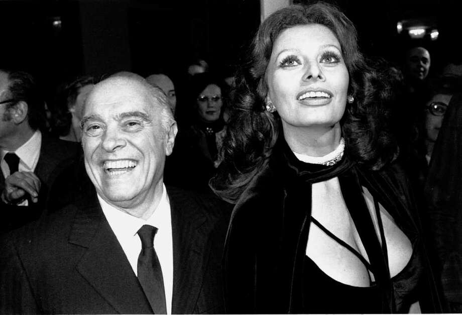 ** FILE ** Film producer Carlo Ponti and actress Sophia Loren are photographed in Dec. 1976 at an unknown location.  Ponti, who risked excommunication from the Roman Catholic church to marry Loren, will celebrate his 90th birthday on Wednesday, Dec. 11, 2002, in Geneva, Switzerland. He looked back at some of the great actors and actresses he has worked with, in an inteview the Swiss newspaper, Blick. Photo: AP