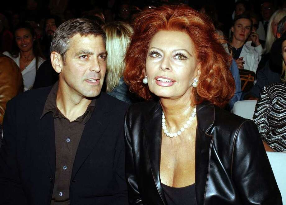 Actor George Clooney, left, and Italian actress Sophia Loren attend the Giorgio Armani Spring-Summer 2003 fashion collection presented in Milan, Italy, Monday, Sept. 30, 2002. (AP Photo/Luca Bruno) Photo: LUCA BRUNO,  AP / AP