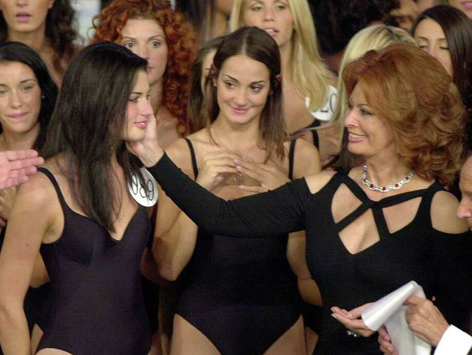 Italian actress and Miss Italy beauty contests jury president Sophia Loren, right, cheers Daniela Ferolla after she was elected Miss Italy 2001 in Salsomaggiore, Italy, Monday, Sept. 10, 2001. Photo: ANTONIO CALANNI, AP / AP
