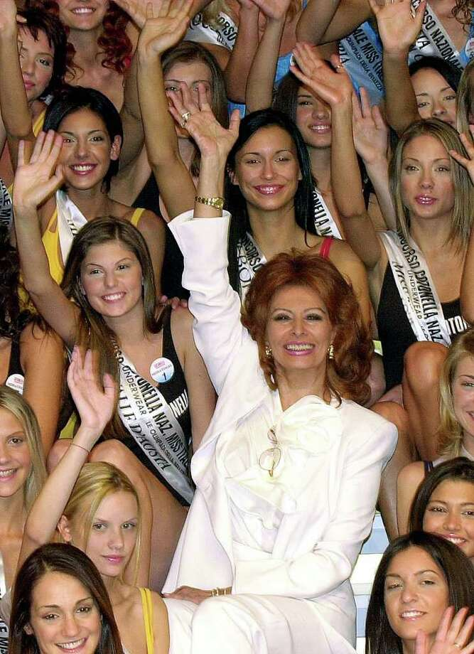 Italian actress Sophia Loren poses with a group of finalists for the Miss Italia 2001 beauty contest in Salsomaggiore, Italy, Monday, Sept. 10, 2001. Loren was a jurist in the competition. Photo: ANTONIO CALANNI, AP / AP