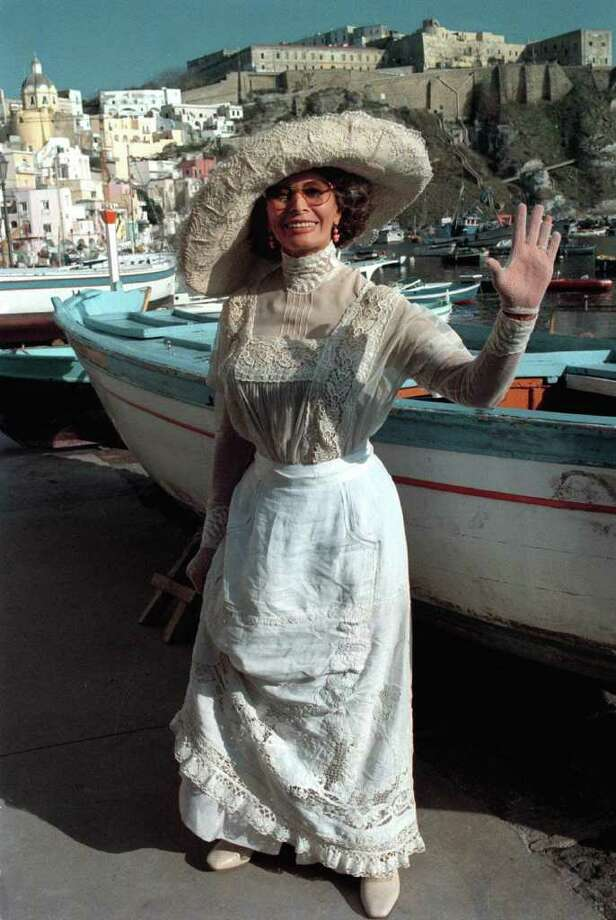 Italian Academy Award winner actress Sophia Loren waves in her costume on location on the island of Procida, near Naples southern Italy, where she is shooting of the film Francesca e Nunziata, with director Lina Wertmuller Monday Nov. 13, 2000. Loren, who has homes in California and Switzerland, returned Sunday to her hometown of Pozzuoli near Naples after a 15-year-absence. Photo: CESARE ABBATE, AP / AP
