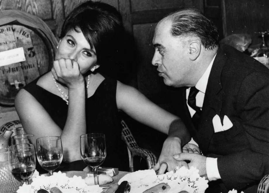 Italian film actress Sophia Loren in a restaurant in France with her husband Carlo Ponti, the man credited with discovering her. Photo: Keystone, Getty Images / Hulton Archive