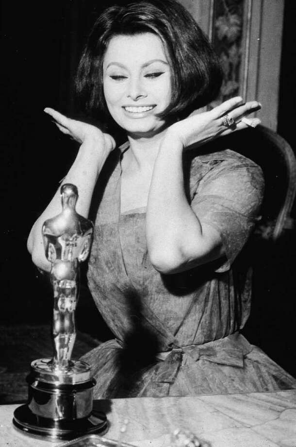 Italian actor Sophia Loren reacts after winning her Best Actress Oscar for the film, 'La Ciociara,' after the Academy Awards, April 1962. Photo: Hulton Archive, Getty Images / 2003 Getty Images