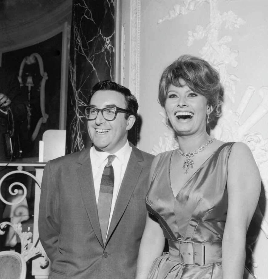 British actor Peter Sellers (1925 - 1980) and Italian actress Sophia Loren attend a press conference at the Ritz Hotel, 18th May 1960. They are about to start filming 'The Millionairess', directed by Anthony Asquith and adapted from a play by George Bernard Shaw. Photo: Keystone, Getty Images / 2004 Getty Images