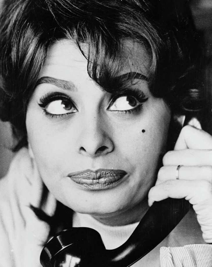 April 1959:  Italian film star, Sophia Loren on the telephone to her mother. At the time, Loren was living in Switzerland with husband film-producer, Carlo Ponti. The couple were unable to return to Italy as Italian law did not recognize their marriage. Photo: Keystone Features, Getty Images / Hulton Archive