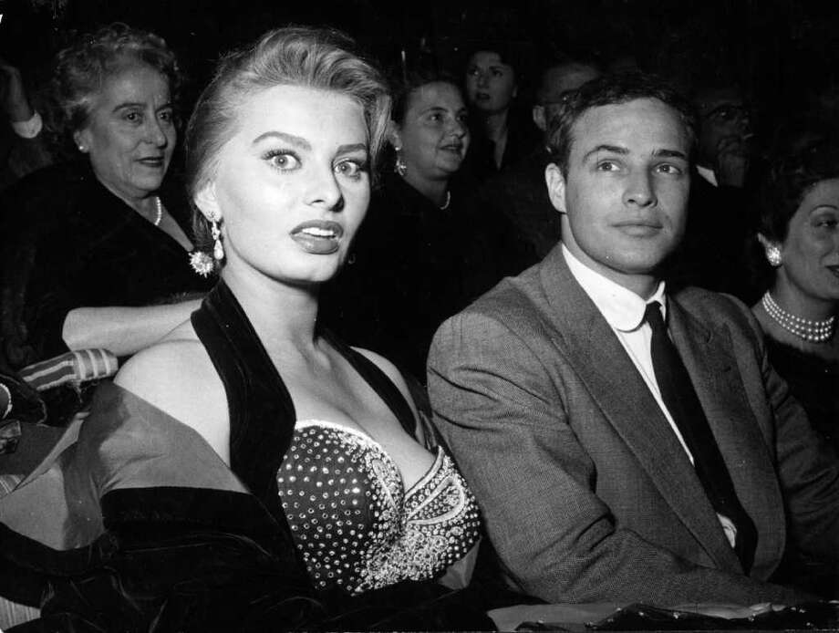11th November 1954:  Italian actress Sophia Loren and US actor Marlon Brando at a cinema in Rome, where Brando received the Francesco Pasinetti Prize for his performance in the film 'On The Waterfront'. Photo: Keystone, Getty Images / Hulton Archive