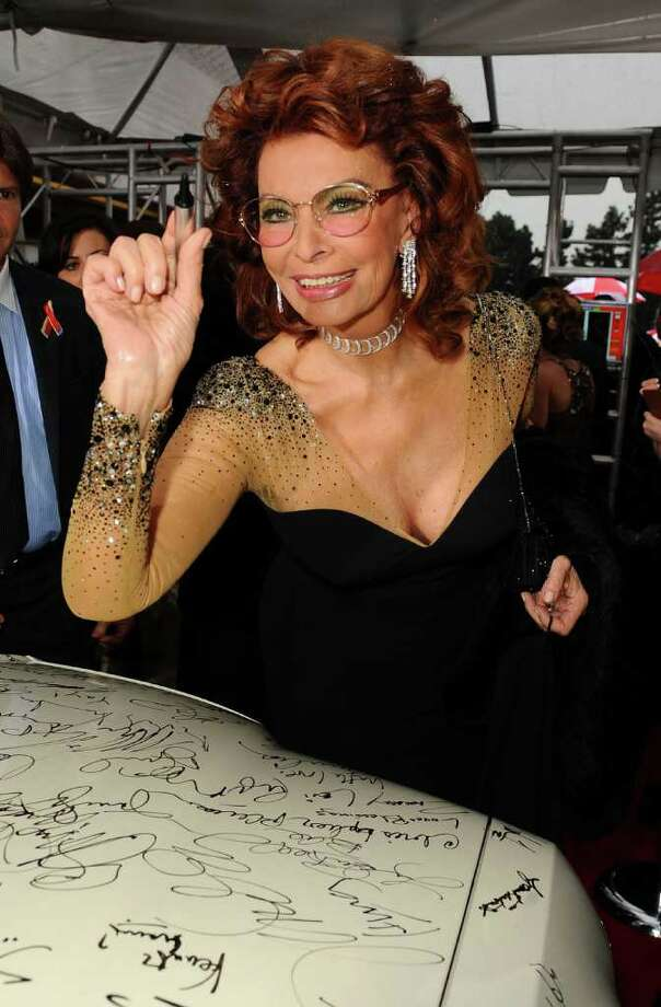BEVERLY HILLS, CA - JANUARY 17:  Actress Sophia Loren signs the Chrysler 300 Eco Style car for Stars for a Cause during the 67th annual Golden Globe Awards held at The Beverly Hilton Hotel on January 17, 2010 in Beverly Hills, California. This Chrysler 300 is one of seven in existence.  (Photo by Michael Caulfield/Getty Images) *** Local Caption *** Sophia Loren Photo: Michael Caulfield, Getty Images / 2010 Getty Images