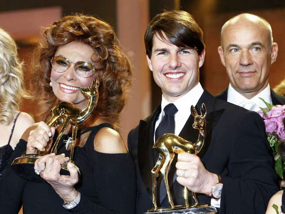 "Italian actress Sophia Loren holds her Bambi category ""Lifetime achievement"" and US actor Tom Cruise his for ""Courage"" during the Bambi media prize awards ceremony, 29 November 2007 in Dusseldorf. The awards ceremony takes place every year under the patronage of German publisher Hubert Burda and awards nominees in the sectors of communication, entertainment and show business as well as economy, politics and sports.   AFP PHOTO  DDP/ TORSTEN SILZ   GERMANY OUT Photo: TORSTEN SILZ, AFP/Getty Images / 2007 AFP"