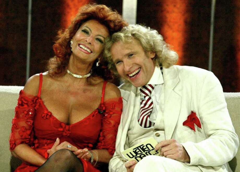 BERLIN, Germany:  Italian film star Sophia Loren shares a laugh with German showmaster Thomas Gottschalk during the 150 edition of the German TV show 'Wetten, Dass...?' ('Let's Bet...?') during a live transmission in Berlin late 02 October 2004. The show, which has celebrity contestants betting on whether outlandish feats can be performed or not, is one of Germany's most popular programmes.  AFP PHOTO MICHAEL URBAN    GERMANY OUT Photo: MICHAEL URBAN, AFP/Getty Images / 2004 AFP