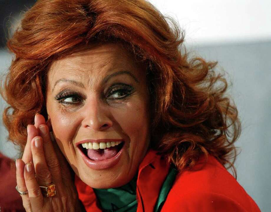 "TORONTO, CANADA:  Italian Actor Sophia Loren laughs during a news conference discussing her new film ""Between Strangers"" which was written and directed by her son Edoardo Ponti, at the Toronto International Film Festival 13 September 2002.   AFP PHOTO/J.P. MOCZULSKI Photo: J.P. MOCZULSKI, AFP/Getty Images / AFP"
