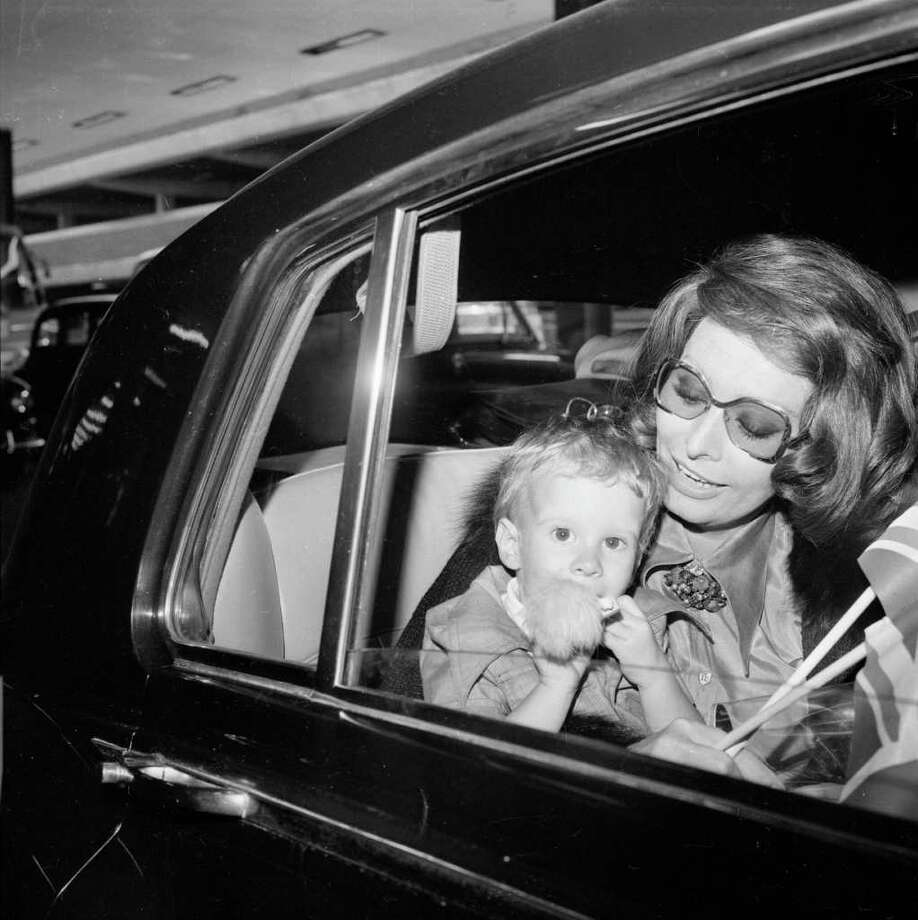 26th June 1974:  Italian actress Sophia Loren at London Airport with her younger son Edoardo Ponti. Photo: R. Brigden, Getty Images / Hulton Archive