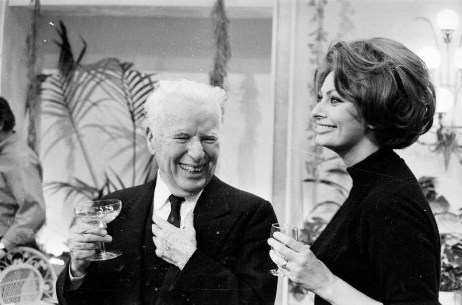 15th April 1966:  English born actor, comedian and film maker Charlie Chaplin with Sophia Loren at his birthday party. Photo: Larry Ellis, Getty Images / Hulton Archive