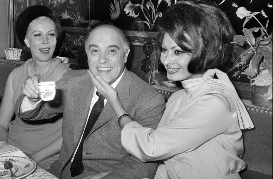 Bougival, FRANCE:  Picture taken 09 April 1966 in Bougival of Italian film star Sophia Loren (R), and his husband Carlo Ponti. Italian film producer Carlo Ponti died overnight at a Geneva hospital, the ANSA news agency reported. He was 94. AFP PHOTO Photo: AFP, AFP/Getty Images / 2007 AFP