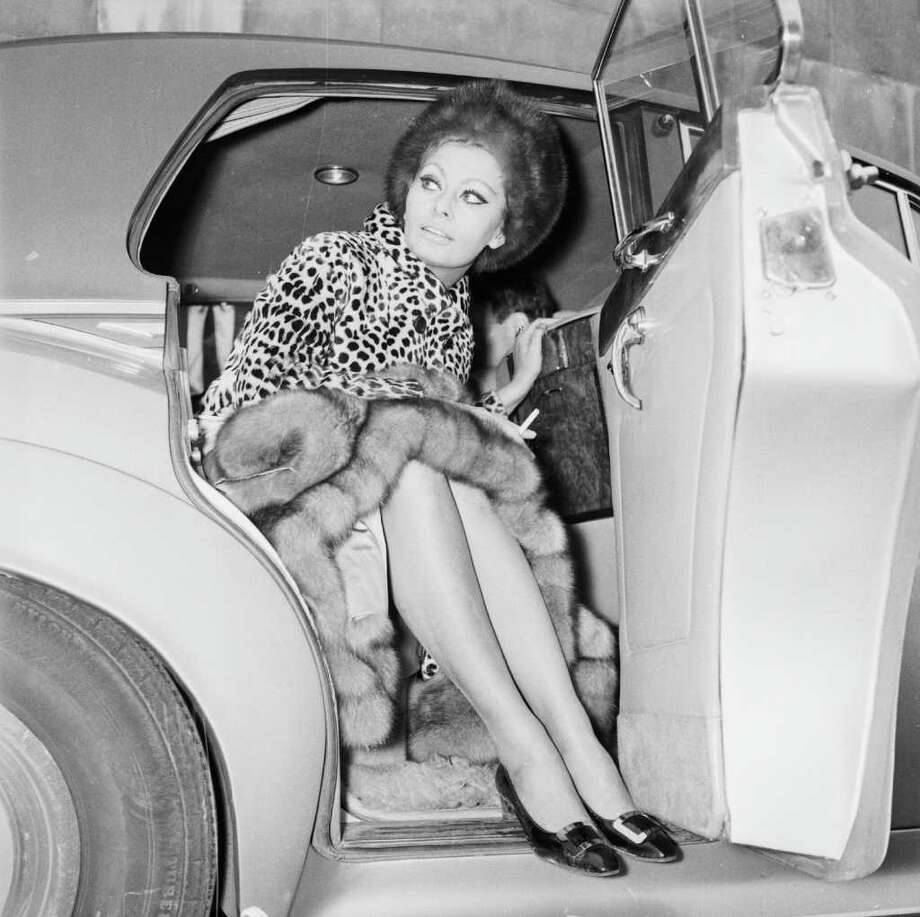15th January 1966:  Italian actress Sophia Loren gets into a car at London Airport. Photo: Dove, Getty Images / Hulton Archive