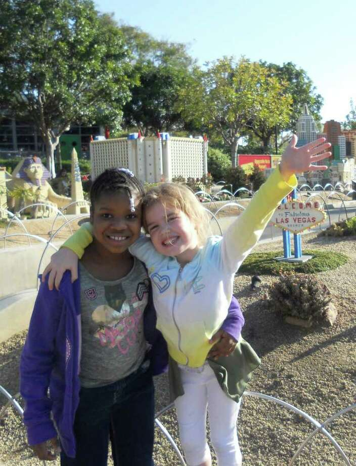 Pictured is Fresh Air Fund child Chyna, 7, of Brooklyn, with Maggie, a member of her Westport host family, at LegoLand in California this past February. Barbara Hennelly, Maggie's mother, involves Chyna in family activites beyond the summer vacation period. Photo: Contributed Photo / Fairfield Citizen contributed