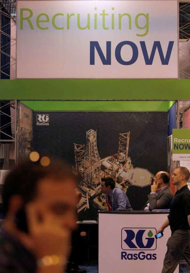 A job recruitment sign hangs over the RasGas booth during the Offshore Technology Conference in Reliant Center Wednesday, May 4, 2011, in Houston. 