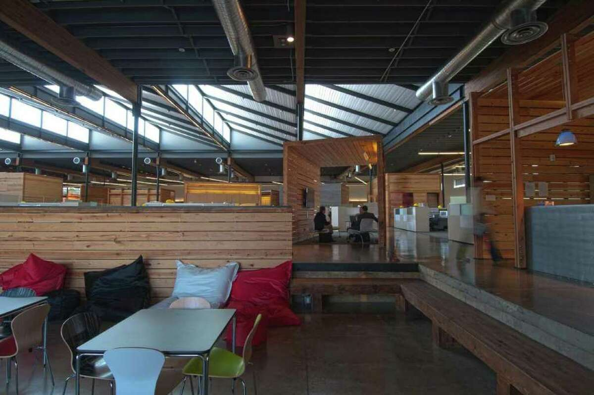 The old loading dock now forms a flexible space adjacent to a kitchen for meeting and events.