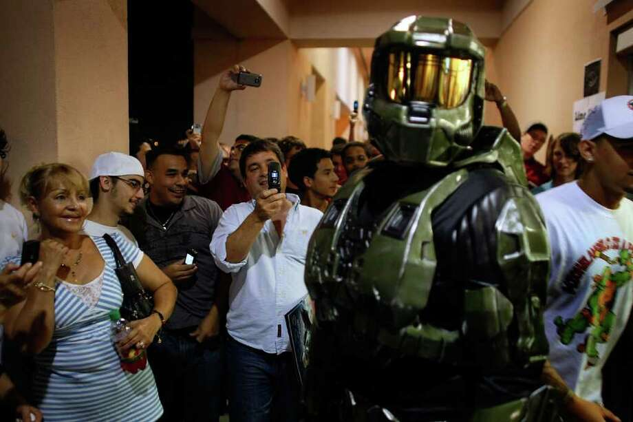 People at at Circuit City in Doral, Fla., take photographs of a person 