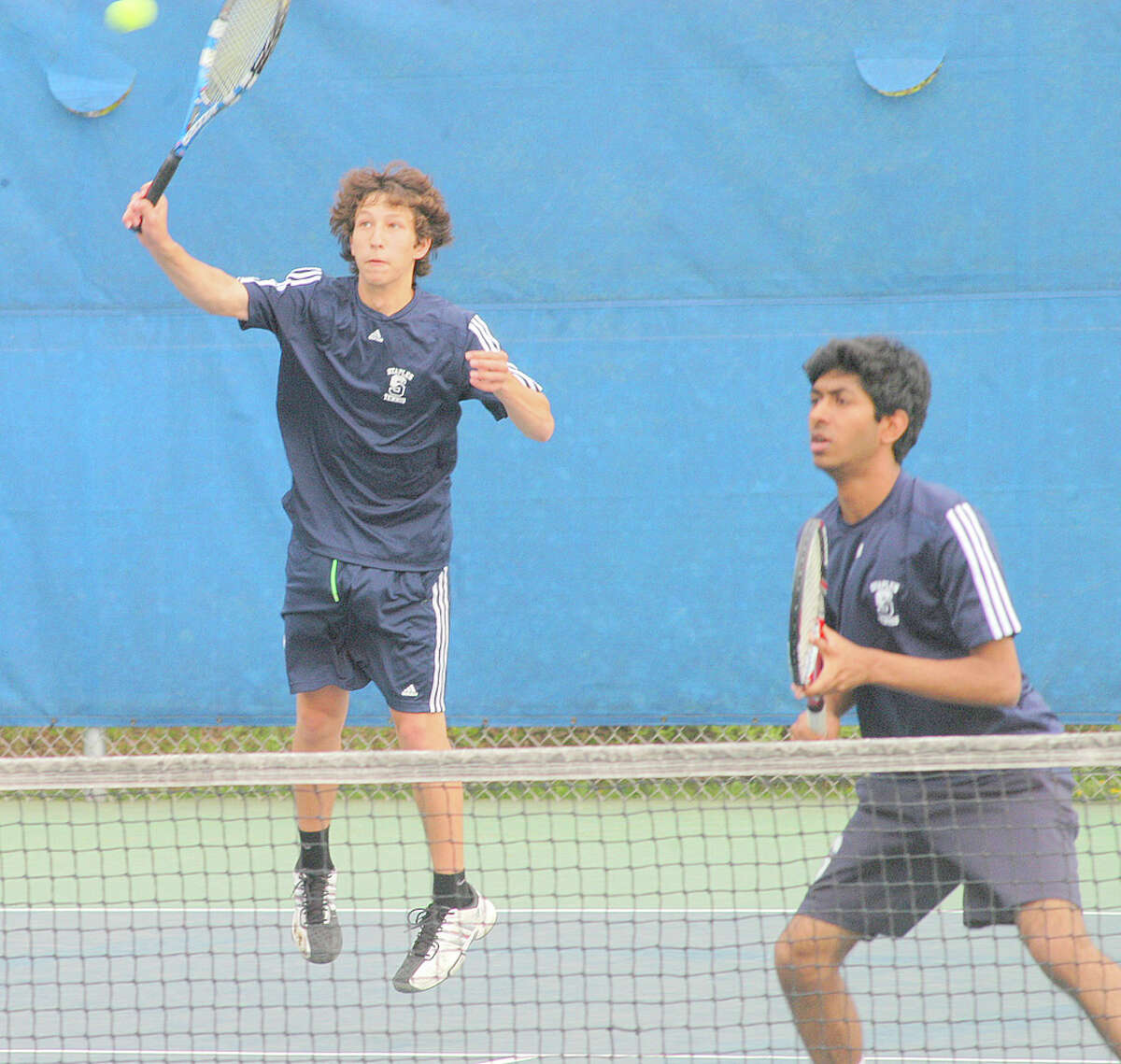 Staples senior Josh Kaseff returns a volley at third doubles Tuesday against Weston. Kaseff and senior Jehnir Hafiz defeated Henry Morris and Ben Lander, 6-3, 6-0 in the Wreckers' 7-0 victory.