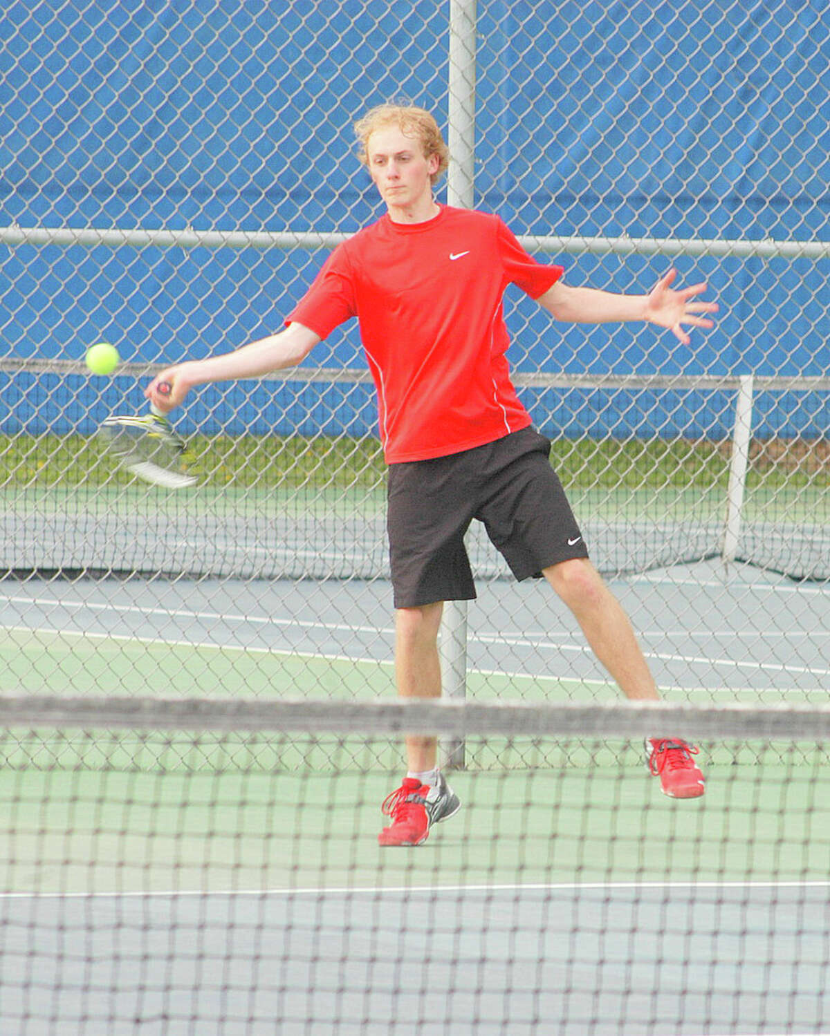 Weston freshman Henry Morris returns a volley at third doubles Tuesday against Staples. Morris and sophomore Ben Lander lost 6-3, 6-0 to seniors Jehnir Hafiz and Josh Kaseff in the Trojans' 7-0 loss to the Wreckers.
