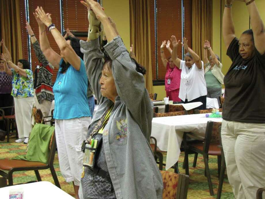 Senior companions practice relaxation exercises during a training session at Morningside Ministries. The Senior Companions Program, led by Christian Senior Services, trains companions on how to provide assistance to homebound residents in Bexar County. Photo: Photo By Natalie Chandler