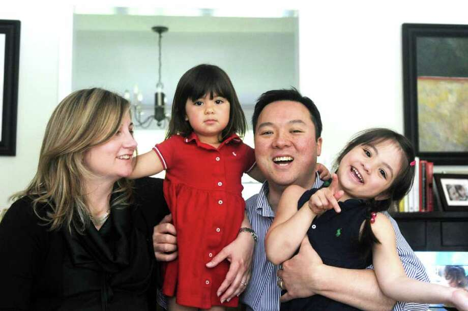 State Rep. William Tong photographed with his wife, Elizabeth, and daughters Penelope. 2. and Elenaor, 5, in his home in Stamford, Conn., May 5, 2011. Photo: Keelin Daly / Stamford Advocate