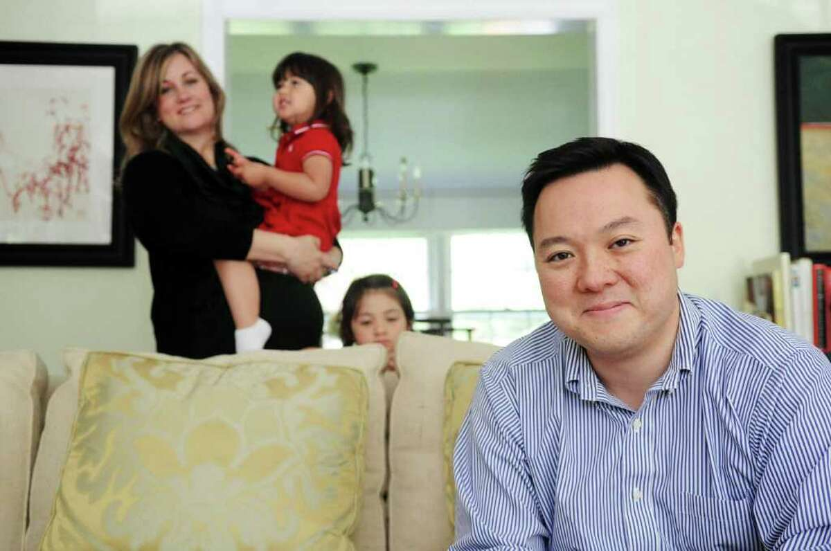 State Rep. William Tong photographed with his wife, Elizabeth, and daughters Penelope. 2. and Elenaor, 5, in his home in Stamford, Conn., May 5, 2011.