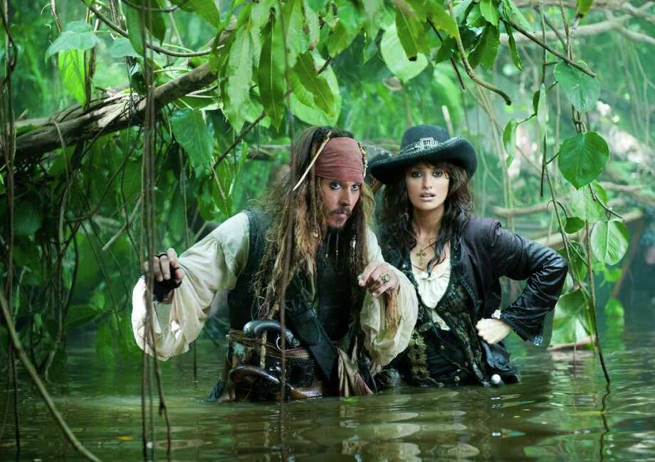 "In this film publicity image released by Disney, Johnny Depp, left, and Penelope Cruz are shown in a scene from, ""Pirates of the Caribbean: On Stranger Tides."" (AP Photo/Disney, Peter Mountain) Photo: Peter Mountain"