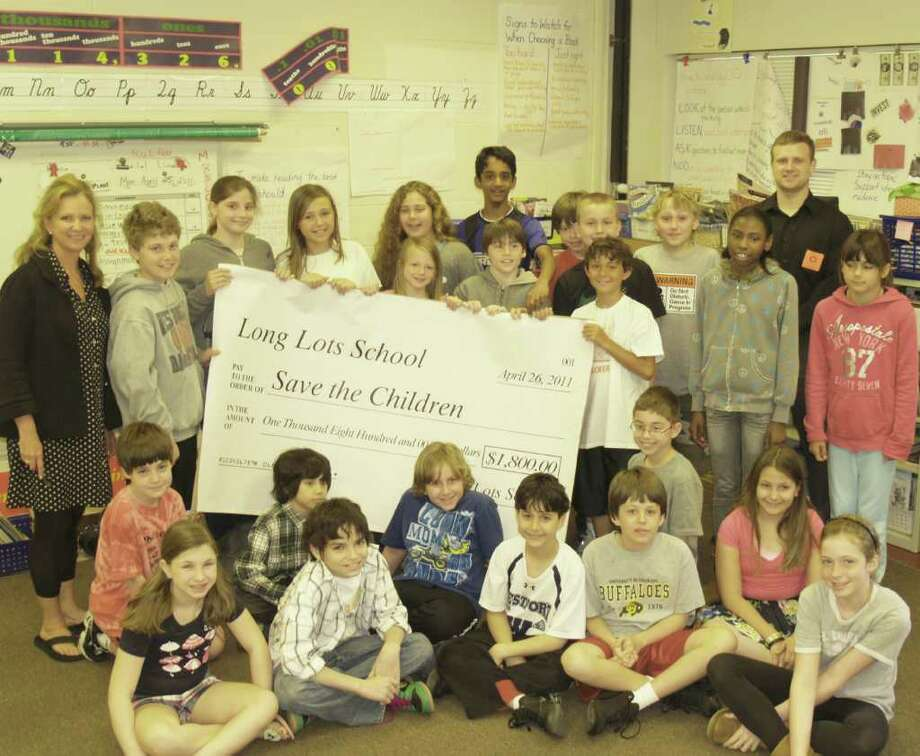 Pictured is Mrs. Lisa Loechner's 5th grade homeroon class, which raised $1,800 to aide in the relief efforts in Japan. A check was presented to Westport-based Save The Children on Tuesday. Photo: Contributed Photo / Westport News contributed